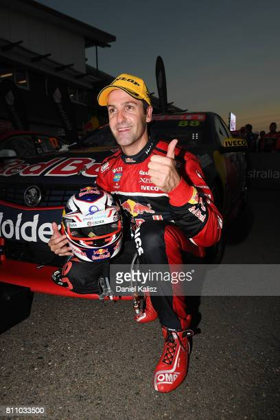 Jamie Whincup driver of the Red Bull Holden Racing Team Holden Commodore VF celebrates after winning race 14 for the Townsville 400 which is part of...