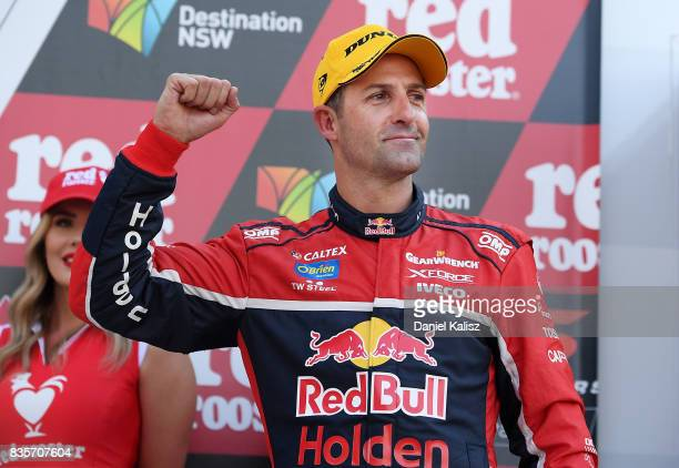Jamie Whincup driver of the Red Bull Holden Racing Team Holden Commodore VF celebrates after winning race 18 for the Sydney SuperSprint which is part...