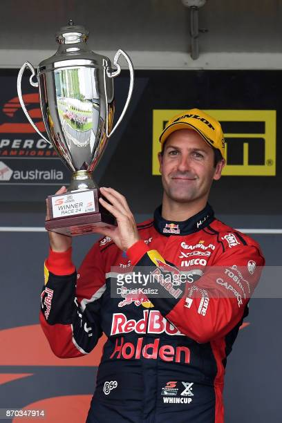 Jamie Whincup driver of the Red Bull Holden Racing Team Holden Commodore VF celebrates after winning reactsace 24 for the Auckland SuperSprint which...