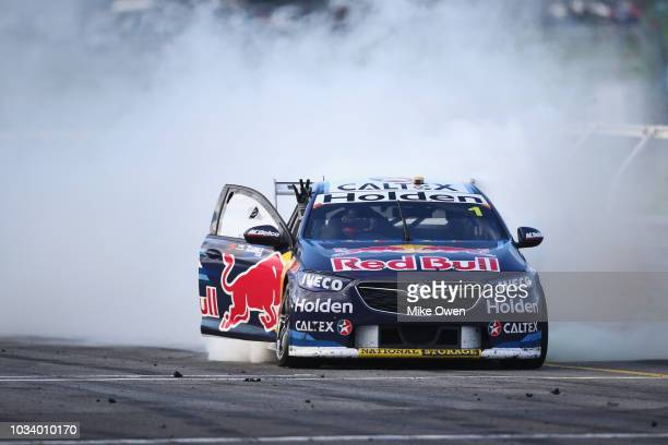Jamie Whincup driver of the Red Bull Holden Racing Team Holden Commodore ZB does a burnout after winning the Supercars Sandown 500 at Sandown...