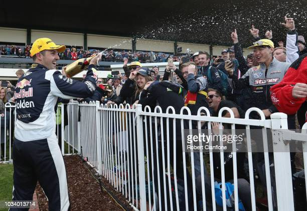 Jamie Whincup driver of the Red Bull Holden Racing Team Holden Commodore ZB celebrates after winning the Sandown 500 at Sandown International Motor...