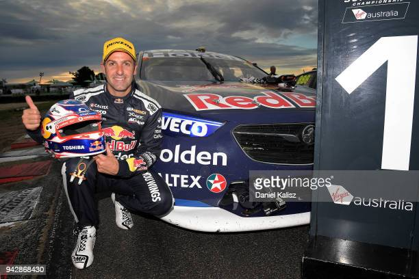Jamie Whincup driver of the Red Bull Holden Racing Team Holden Commodore ZB celebrates after winning race 1 for the Supercars Tasmania SuperSprint on...
