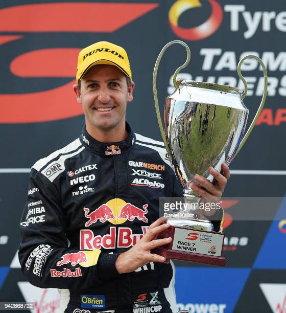 Jamie Whincup driver of the Red Bull Holden Racing Team Holden Commodore ZB poses for a photo with his Ben Rohrer of the Sydney Thunderphy after...