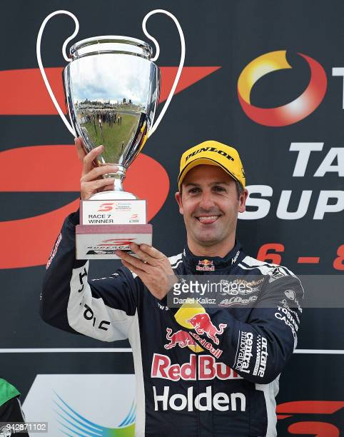 Jamie Whincup driver of the Red Bull Holden Racing Team Holden Commodore ZB celebrates on the podium after winning race 1 for the Supercars Tasmania...