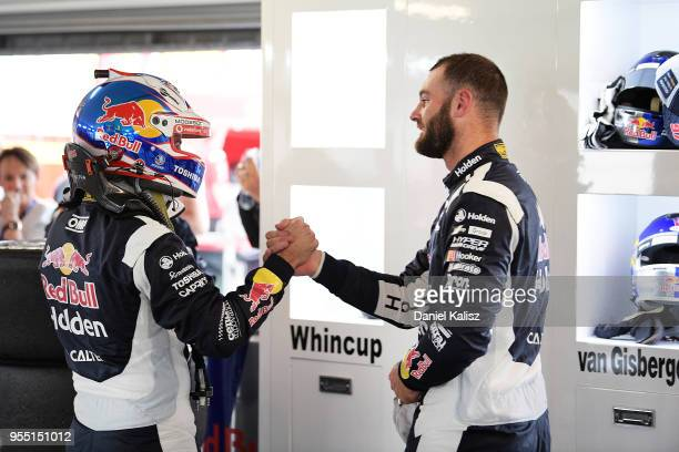 Jamie Whincup driver of the Red Bull Holden Racing Team Holden Commodore ZB congratulates Shane Van Gisbergen driver of the Red Bull Holden Racing...