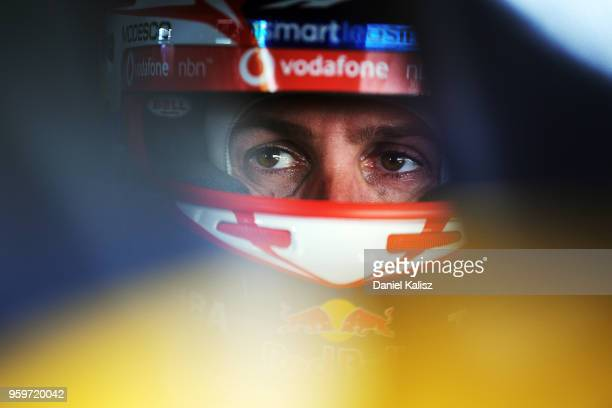 Jamie Whincup driver of the Red Bull Holden Racing Team Holden Commodore ZB looks on during practice for the Supercars Winton SuperSprint on May 18...