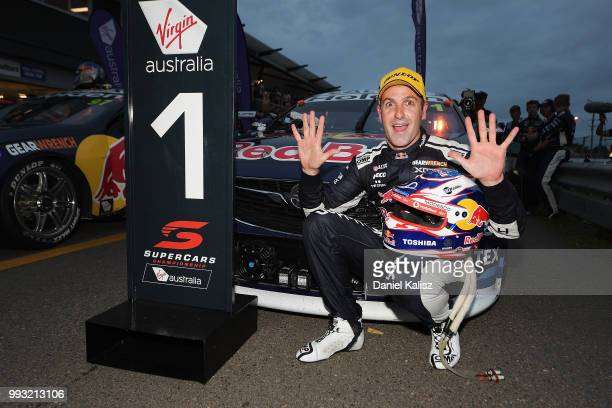 Jamie Whincup driver of the Red Bull Holden Racing Team Holden Commodore ZB celebrates after winning race 17 for the Supercars Townsville 400 on July...