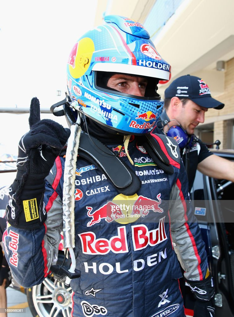 Jamie Whincup driver of the #1 Red Bull Racing Australia Holden celebrates after qualifying on pole for race 14 for the Austin 400, which is round five of the V8 Supercar Championship Series at Circuit of The Americas on May 18, 2013 in Austin, Texas.