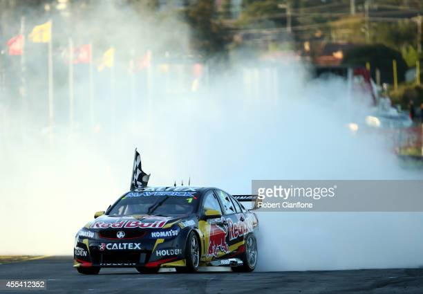 Jamie Whincup driver of the Red Bull Racing Australia Holden celebrates after winning the Sandown 500 which is race 29 of the V8 Supercar...