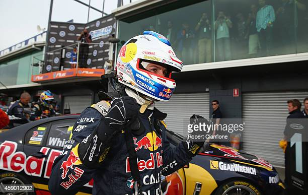Jamie Whincup driver of the Red Bull Racing Australia Holden celebrates after he won race 34 at the Phillip Island 400 which is part of the V8...