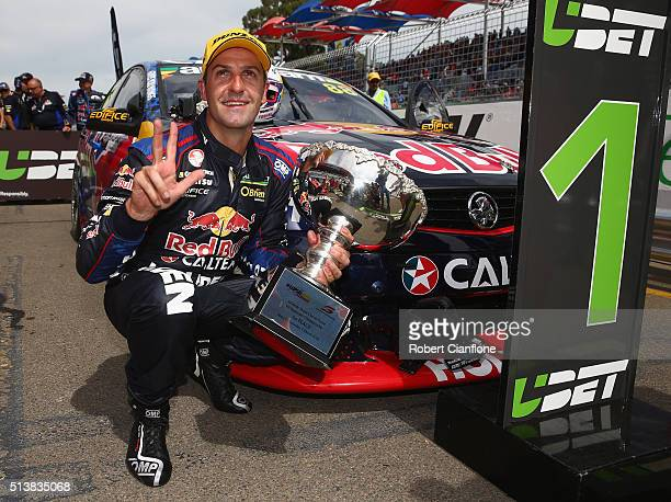 Jamie Whincup driver of the Red Bull Racing Australia Holden celebrates after winning race one for the V8 Supercars Clipsal 500 at Adelaide Street...