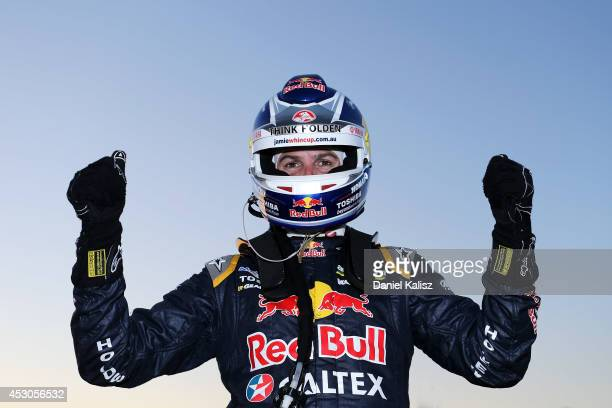 Jamie Whincup driver of the Red Bull Racing Australia Holden celebrates in parc ferme after winning race 24 for the Ipswich 400 which is round eight...