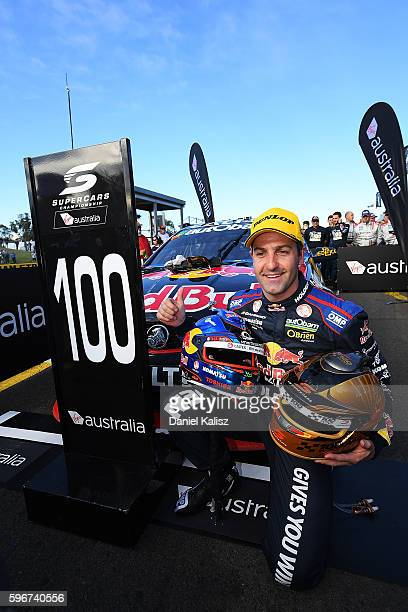 Jamie Whincup driver of the Red Bull Racing Australia Holden Commodore VF celebrates after winning his 100th race and race 2 for the V8 Supercars...