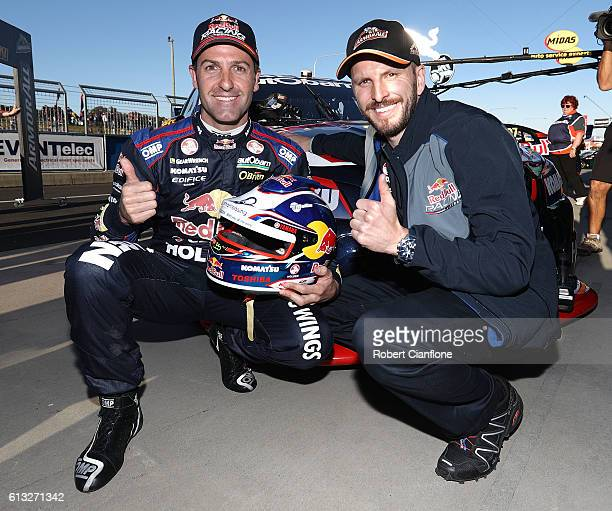 Jamie Whincup driver of the Red Bull Racing Australia Holden celebrates with team mate Paul Dumbrell after taking pole position for the Bathurst 1000...
