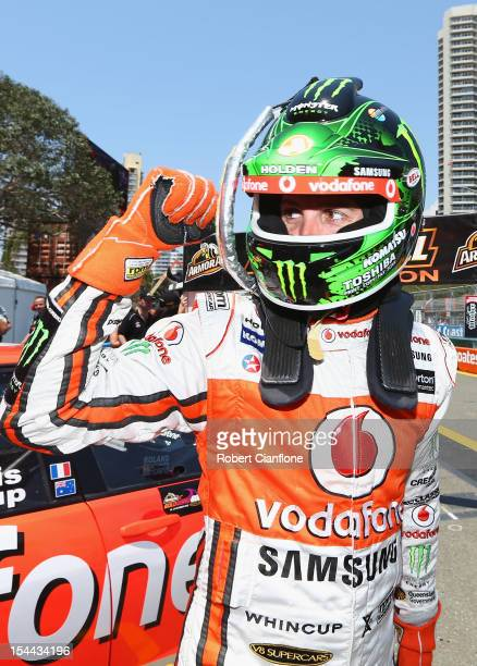 Jamie Whincup driver of the Team Vodafone Holden celebrates after he took pole position in the Top 10 Shootout for the Gold Coast 600 which is round...