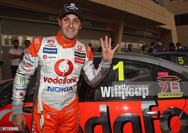 Jamie Whincup driver of the Team Vodafone Holden celebrates after winning race two for round two of the V8 Supercar Championship Series at Bahrain...