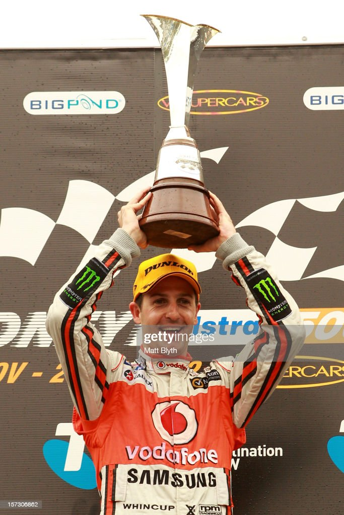 Jamie Whincup driver of the #1 Team Vodafone Holden celebrates winning the 2012 Championship after the Sydney 500, which is round 15 of the V8 Supercars Championship Series at Sydney Olympic Park Street Circuit on December 2, 2012 in Sydney, Australia.