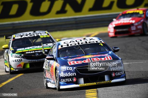 Jamie Whincup drives the Red Bull Holden Racing Team Holden Commodore ZB leads Craig Lowndes drives the Autobarn Lowndes Racing Holden Commodore ZB...
