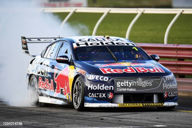 Jamie Whincup drives the Red Bull Holden Racing Team Holden Commodore ZB celebrates after winning race 24 for the Supercars Sandown 500 at Sandown...