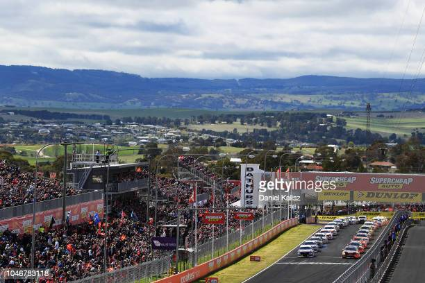 Jamie Whincup drives the Red Bull Holden Racing Team Holden Commodore ZB and David Reynolds drives the Erebus Penrite Racing Holden Commodore ZB are...