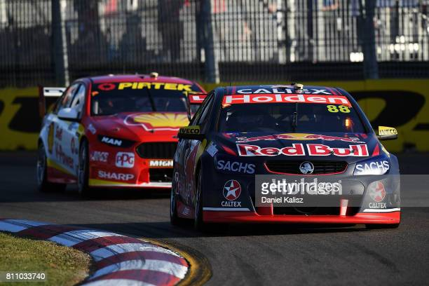 Jamie Whincup drives the Red Bull Holden Racing Team Holden Commodore VF leads Scott McLaughlin drives the Shell VPower Racing Team Ford Falcon FGX...