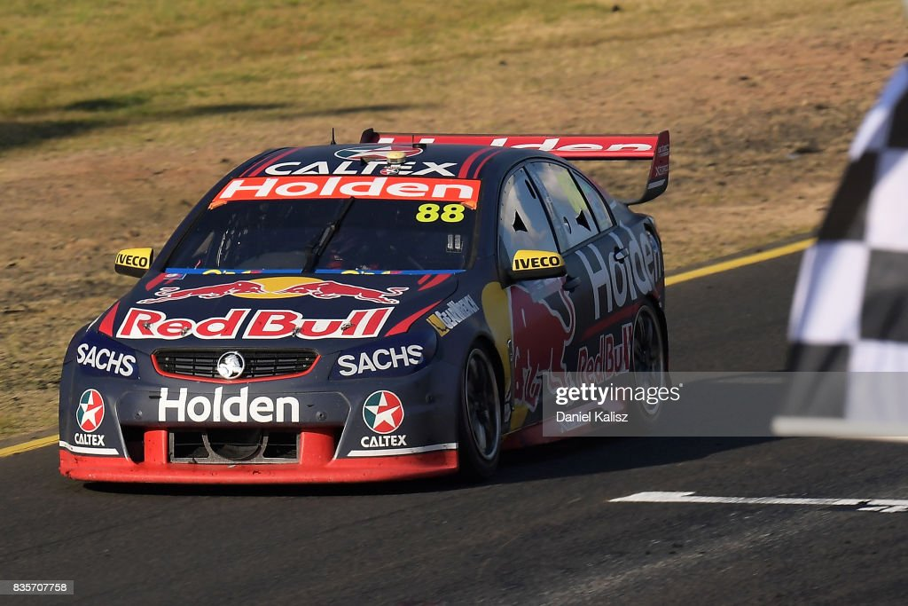 Jamie Whincup drives the #88 Red Bull Holden Racing Team Holden Commodore VF takes the chequred flag to win race 18 for the Sydney SuperSprint, which is part of the Supercars Championship at Sydney Motorsport Park on August 20, 2017 in Sydney, Australia.