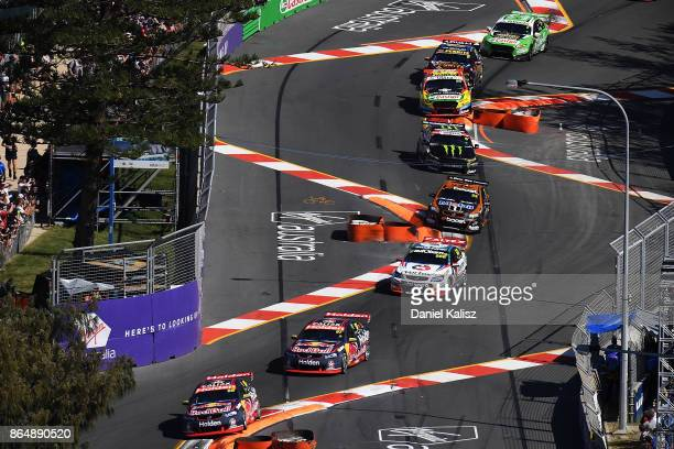Jamie Whincup drives the Red Bull Holden Racing Team Holden Commodore VF leads the field on lap one during race 22 for the Gold Coast 600 which is...