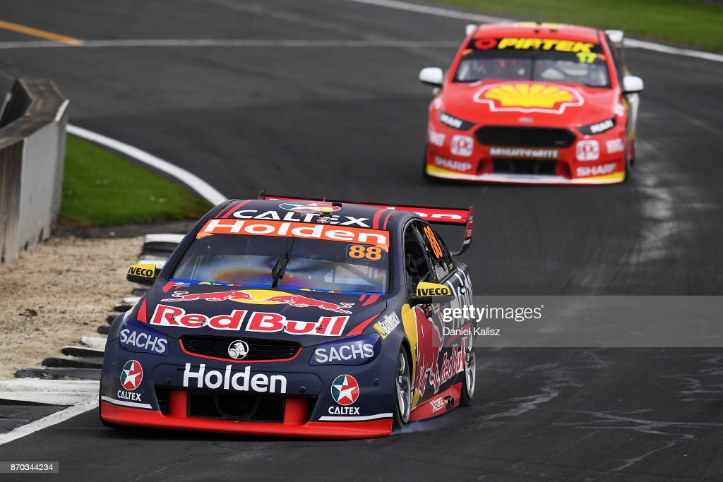 Jamie Whincup drives the #88 Red Bull Holden Racing Team Holden Commodore VF leads Scott McLaughlin drives the #17 Shell V-Power Racing Team Ford Falcon FGX during race 24 for the Auckland SuperSprint, which is part of the Supercars Championship at Pukekohe Park Raceway on November 5, 2017 in Pukekohe, New Zealand.
