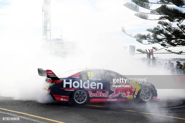 Jamie Whincup drives the Red Bull Holden Racing Team Holden Commodore VF celebrates with a burnout after winning race 26 and the 2017 Supercars...
