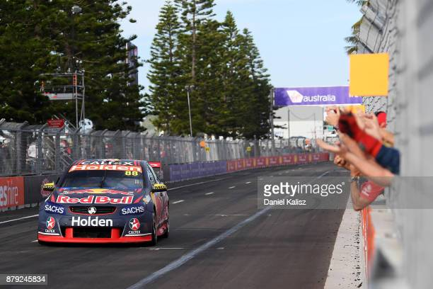 Jamie Whincup drives the Red Bull Holden Racing Team Holden Commodore VF crosses the finish line to win race 26 and the 2017 Supercars Drivers...