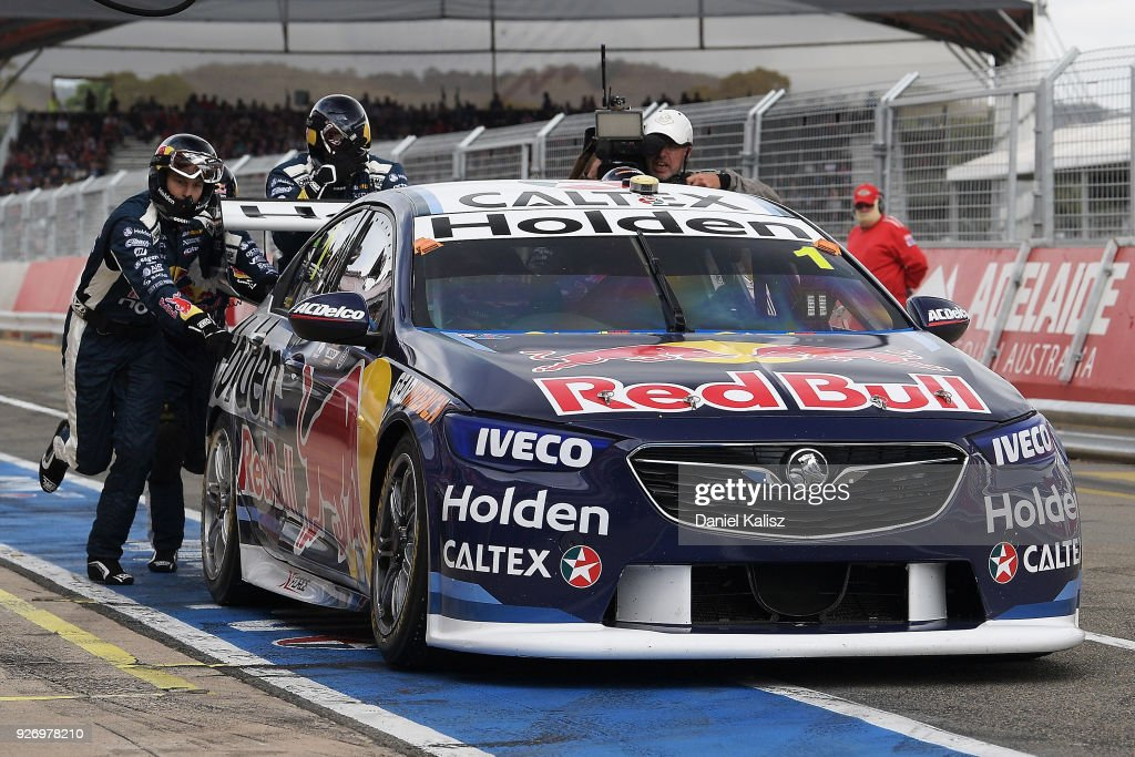 Jamie Whincup drives the #1 Red Bull Holden Racing Team Holden Commodore ZB is pushed by his team after breaking down during race 2 for the Supercars Adelaide 500 on March 2, 2018 in Adelaide, Australia.