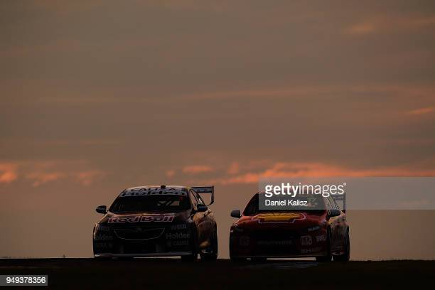 Jamie Whincup drives the Red Bull Holden Racing Team Holden Commodore ZB is passed by Scott McLaughlin drives the Shell VPower Racing Team Ford...