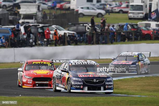 Jamie Whincup drives the Red Bull Holden Racing Team Holden Commodore ZB leads Scott McLaughlin drives the Shell VPower Racing Team Ford Falcon FGX...