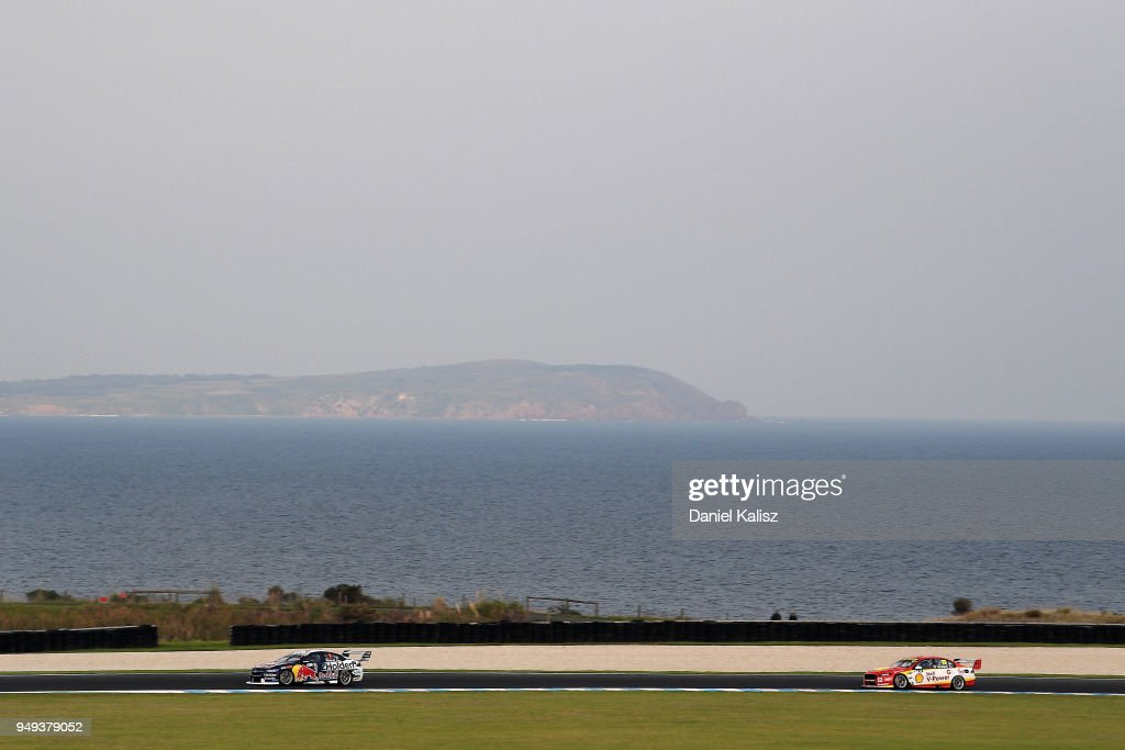 Jamie Whincup drives the #1 Red Bull Holden Racing Team Holden Commodore ZB leads Scott McLaughlin drives the #17 Shell V-Power Racing Team Ford Falcon FGX during the Supercars Phillip Island 500 at Phillip Island Grand Prix Circuit on April 21, 2018 in Phillip Island, Australia.
