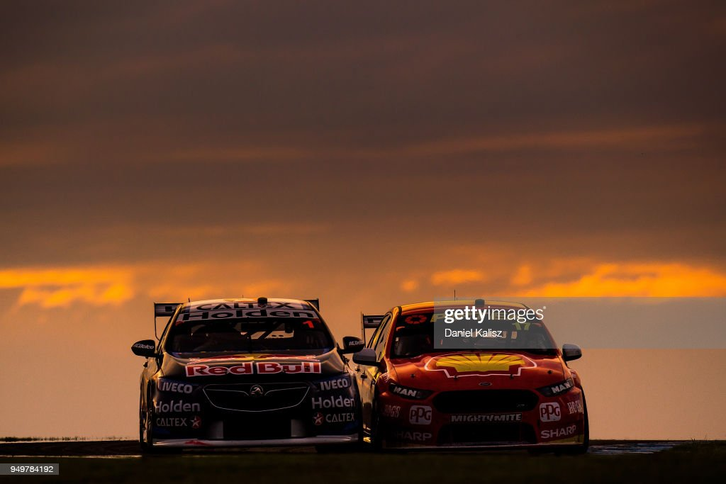 Jamie Whincup drives the #1 Red Bull Holden Racing Team Holden Commodore ZB is passed by Scott McLaughlin drives the #17 Shell V-Power Racing Team Ford Falcon FGX during the Supercars Phillip Island 500 at Phillip Island Grand Prix Circuit on April 21, 2018 in Phillip Island, Australia.
