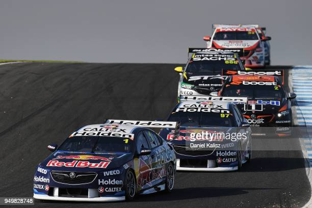 Jamie Whincup drives the Red Bull Holden Racing Team Holden Commodore ZB leads Shane Van Gisbergen drives the Red Bull Holden Racing Team Holden...