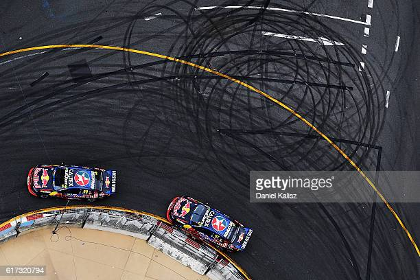 Jamie Whincup drives the Red Bull Racing Australia Holden Commodore VF leads Shane Van Gisbergen drives the Red Bull Racing Australia Holden...