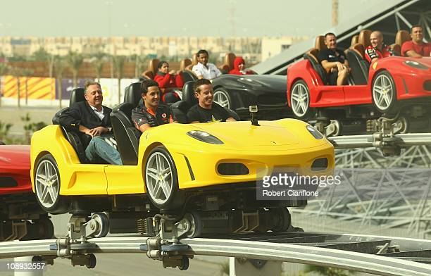 Jamie Whincup of Team Vodafone and James Courtney of the Toll Holden Racing Team take a ride on a rollercoaster at Ferrari World on February 9 2011...