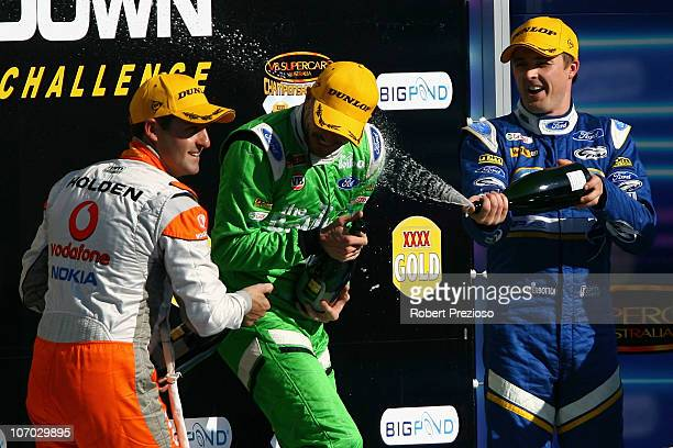 Jamie Whincup Paul Dumbrell and Mark Winterbottom celebrate after race 23 for round 13 of the V8 Supercar Championship Series at Sandown...