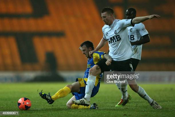 Jamie White of Salisbury City in action with Chris Robertson of Port Vale during the FA Cup Second Round match between Port Vale and Salisbury City...