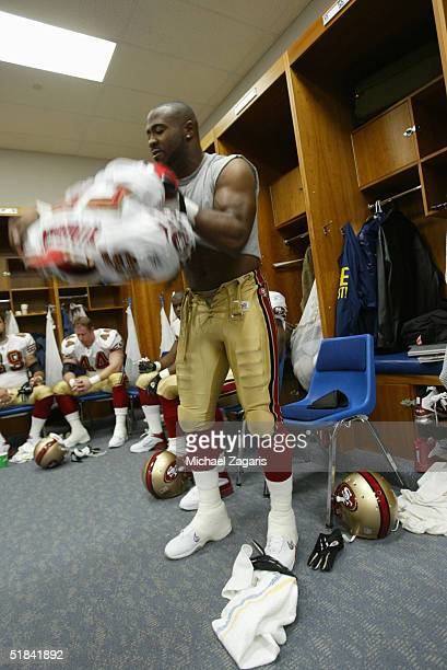 Jamie Winborn of the San Francisco 49ers gets dressed in the locker room before the game against the St Louis Rams at the Edward Jones Dome on...