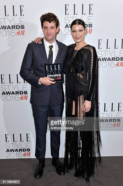 Jamie XX poses with his award for Album of The Year with Bella Hadid in the winners room at The Elle Style Awards 2016 on February 23 2016 in London...
