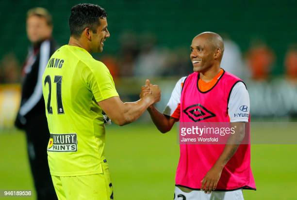 Jamie Young and Henrique Silva of the Brisbane Roar congratulate each other after the round 27 ALeague match between the Perth Glory and the Brisbane...