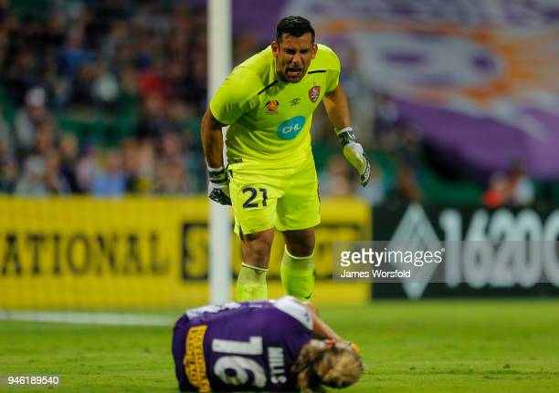 Jamie Young of the Brisbane Roar yells at Joseph Mills of the Perth Glory to get up after a collision during the round 27 ALeague match between the...