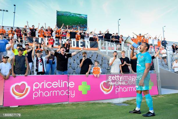 Jamie Young of the Roar celebrates with fans after his team's victory during the A-League match between the Brisbane Roar and the Melbourne Victory...