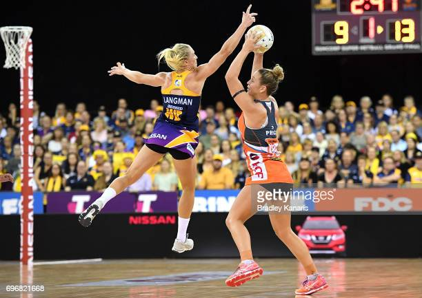 JamieLee Price of the Giants is pressured by the defence of Laura Langman of the Lightning during the Super Netball Grand Final match between the...