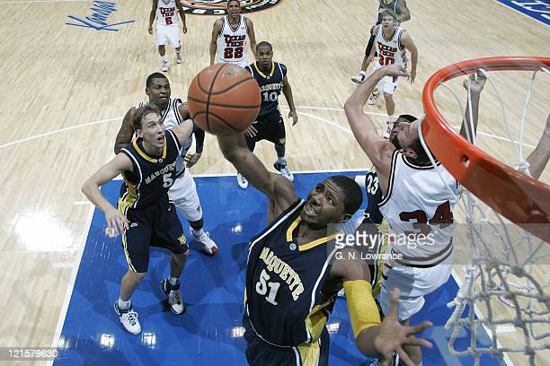 Jamil Lott of Marquette grabs a rebound during semifinal action between Texas Tech and Marquette at the annual CBE Classic at Municipal Auditorium in...