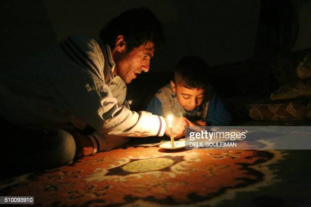 Jamil Murad a 44year old director who learned the Kurdish language in secret while growing helps his eightyearold son Raman complete his homework in...
