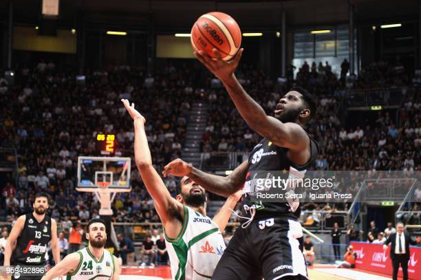 Jamil Wilson and Klaudio Ndoja of Segafredo competes with Thomas Scrubb and Lorenzo D'Ercole of Sidigas during the LBA LegaBasket match between...