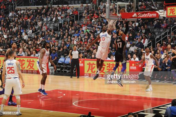 Jamil Wilson of the LA Clippers attempts to block the shot by Garrett Temple of the Sacramento Kings during the game between the two teams on...